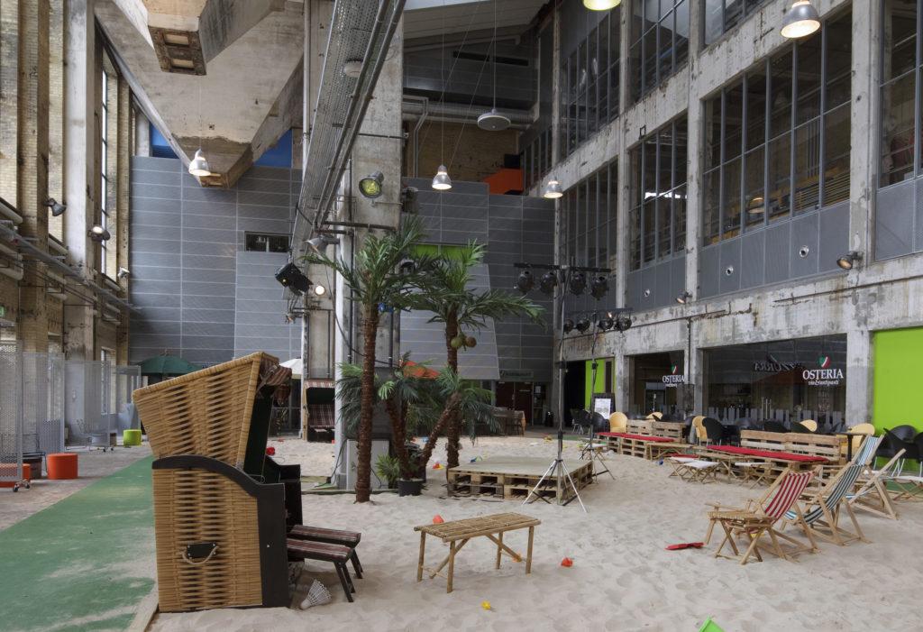 Main Hall, With Indoor Beach. Nordkraft, Aalborg, Denmark. Architect: Cubo, 2009.