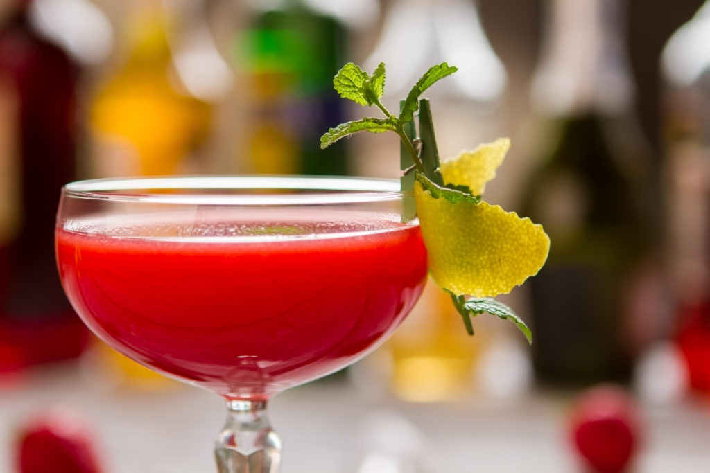 Red cocktail in coupe glass.