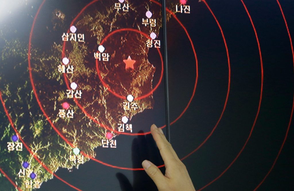 A official of Earthquake and Volcano of the Korea Monitoring Division Director points at the epicenter of seismic waves in North Korea, in Seoul, South Korea, Friday, Sept. 9, 2016. South Korea, Friday, Sep. 9, 2016. South Korea's Yonhap news agency says Seoul believes North Korea has conducted its fifth nuclear test explosion.(AP Photo/Ahn Young-joon)