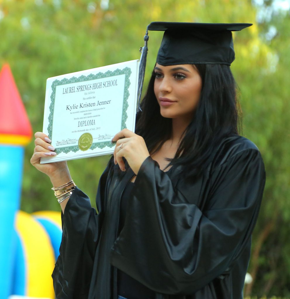 EXCLUSIVE: PREMIUM RATES APPLY Inside Kendall and Kylie Jenner's graduation party in LA photos taken on July 23rd 2015 at 6:30pm. Exclusive look inside the party that was a total surprise for Kendall Jenner and Kylie Jenner as they were welcomed by friends and family. Khloe Kardashian got an extra surprise as they were able to honor her with her first diploma also as she got her very own cap and gown and was able to join her sisters on stage as Ryan Seacrest was the host of the event. The girls posed outside the house also for photos with their diplomas and a photo booth while Khloe even jumped in a blowup jumpy house that was on site next to the pool area. Pictured: Kendall Jenner, Kylie Jenner, Khloe Kardashian Ref: SPL1088147 270715 EXCLUSIVE Picture by: Splash News Splash News and Pictures Los Angeles:310-821-2666 New York: 212-619-2666 London: 870-934-2666 photodesk@splashnews.com All Over Press