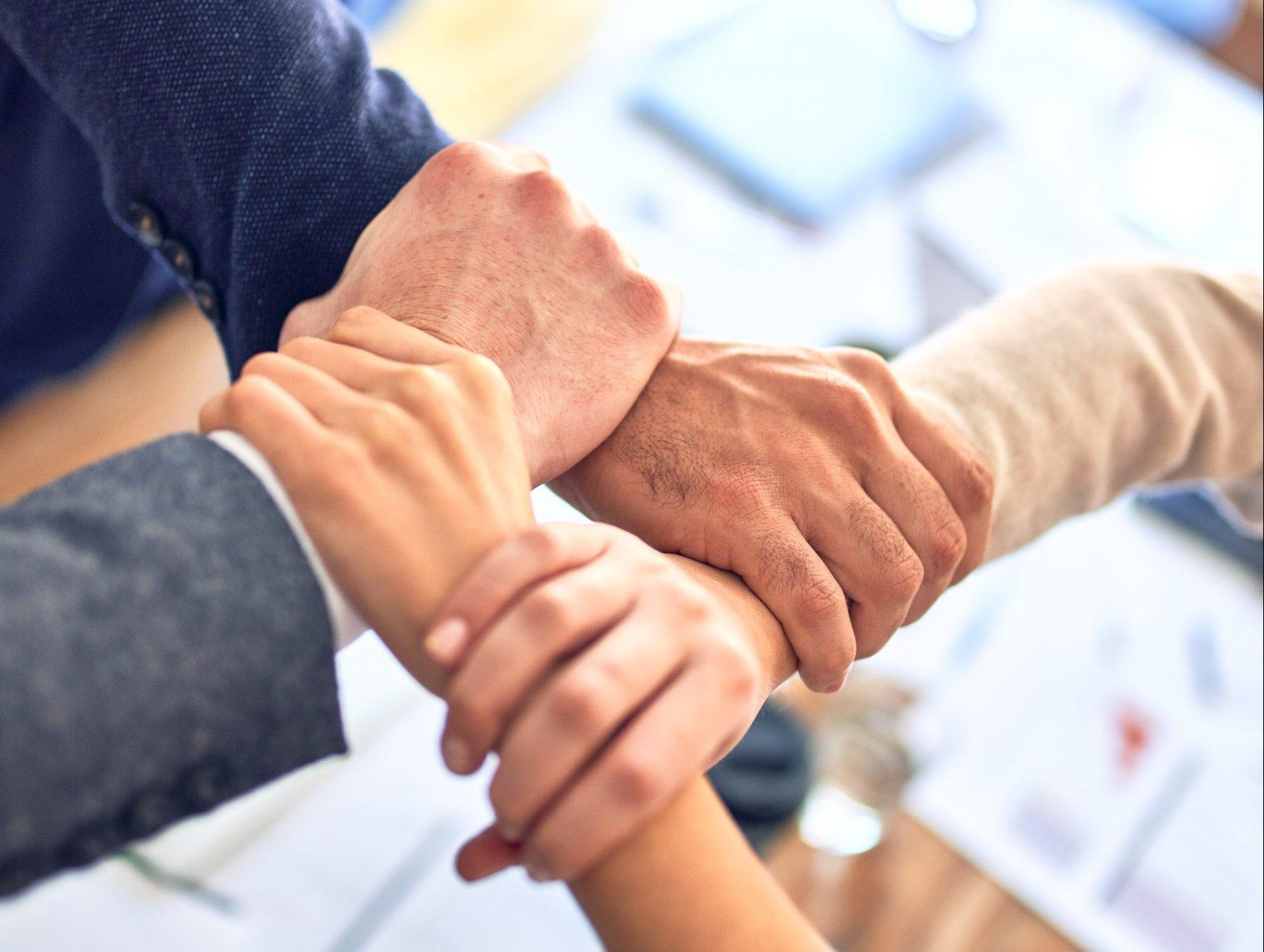 leder, sammenhold, kollegaer (Foto: Unsplash)